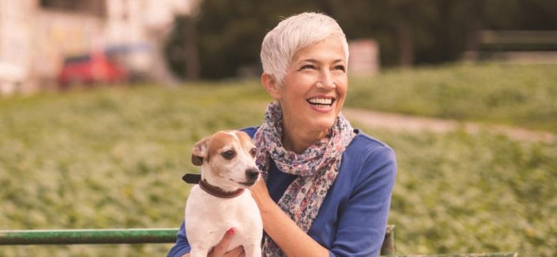 woman enjoying outside with dog